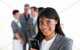 Charming businesswoman sending a text