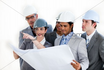 A diverse group of architects studying a plan