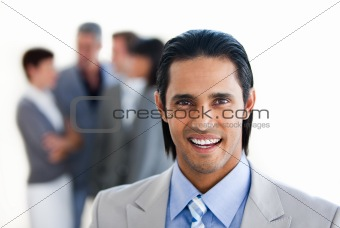 Charming businessman in front of his team