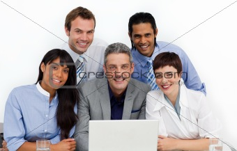 Multi-ethnic business group using a laptop