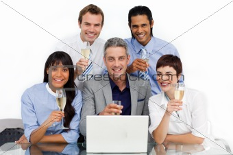 Successfull business team toasting with Champagne
