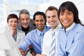 Multi-ethnic smiling business team sitting in a row