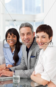 A diverse business team sitting in a row