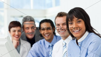 A business group showing diversity smiling at the camera