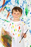 Little child playing with painting