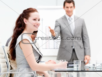 Portrait of a concentrated businesswoman during a meeting