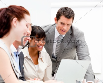Portrait of a concentrated businesswoman working with her collea