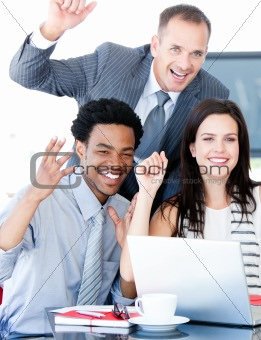 Confident business partners working at a computer in the office