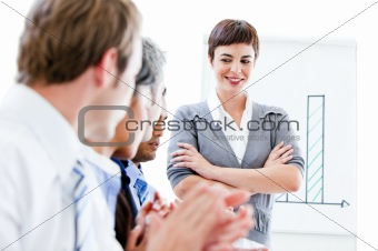 Portrait of a confident businesswoman looking at her colleague d