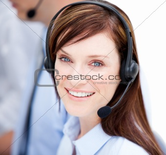 Portrait of caucasian businesswoman with headset on
