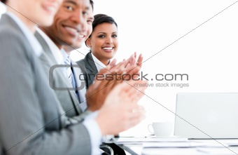 Close up of a multi-ethnic business team applauding a presentati