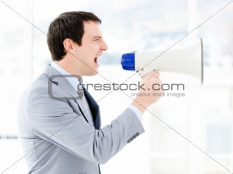 Portrait of an pretty businessman using a megaphone