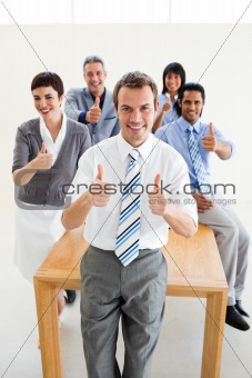 Fortunate international business team with thumbs up