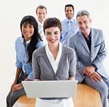 Enthusiastic business people using a laptop