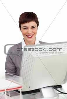 Smiling businesswoman working at her computer