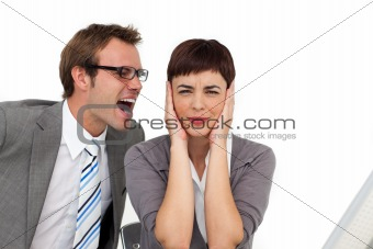 Stressed businessman shouting into his colleague's ear