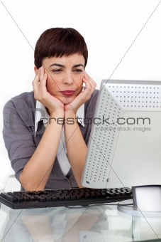 Bored businesswoman looking at her computer