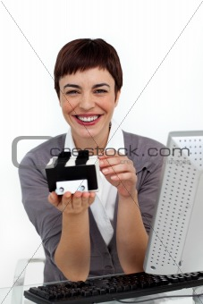 Smiling businesswoman holding a business card holder