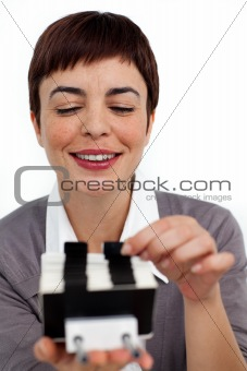 Confident businesswoman consulting a business card holder