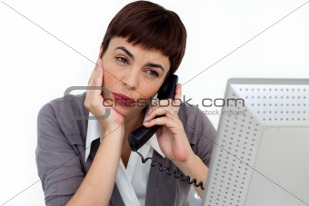 Attractive Businesswoman on phone at her desk