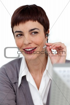 Assertive businesswoman with headset on