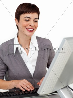 Positive female executive working at her computer
