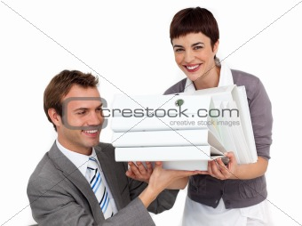 Smiling Businesswoman bringing a stack of folders