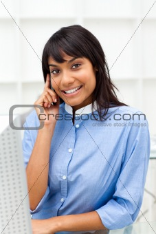 Delighted ethnic businesswoman on phone
