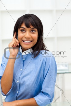 Glowing ethnic businesswoman on phone