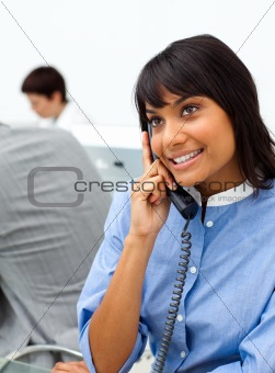 Cute ethnic businesswoman on phone