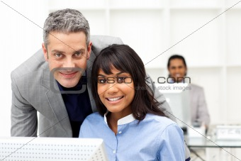Two colleagues working together at a computer