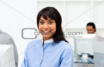 Attractive ethnic businesswoman working at a computer