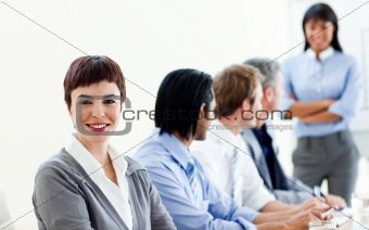 Attractive businesswoman in a meeting with her colleagues