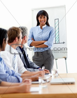 Assertive ethnic businesswoman doing a presentation to her team