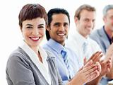A diverse business group clapping a good presentation