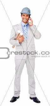 Smiling architect on phone carrying blueprints