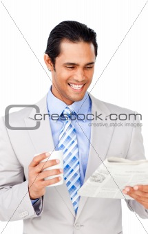 Attractive asian businessman driking coffee and reading a newspa