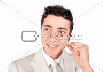 Positive ethnic businessman with headset on