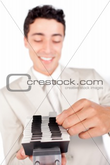 Assertive businessman consulting a business card holder