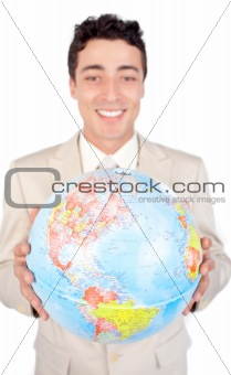 Assertive male executive holding a terrestrial globe