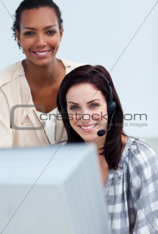 Afro-american businesswoman helping her colleague