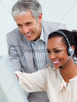 Charismatic businessman helping his colleague