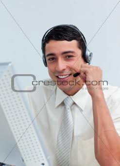 Assertive businessman talking on headset