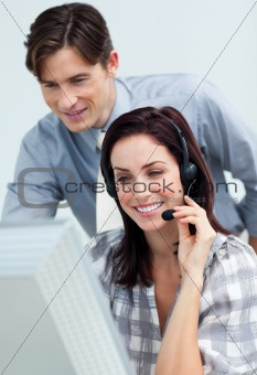 Smiling businessman helping his colleague