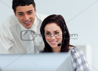Assertive manager checking his employee's work