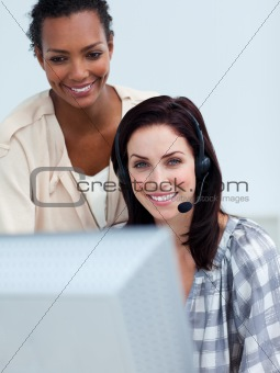 Smiling business partners working at a computer