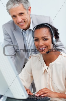 Smiling business people working at a computer