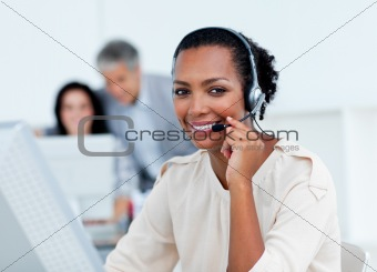 Positive business partners working at computers