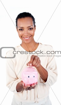 Charming businesswoman saving money in a piggybank