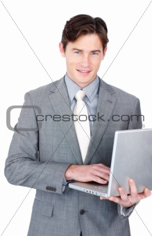 Charming businessman using a laptop